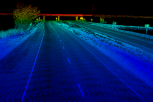 Lidar point cloud of rural stretch of highway with overpass in distance