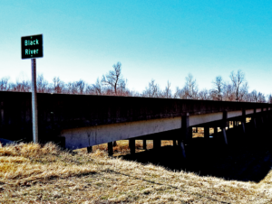 "Overpass with ""Black River"" traffic sign in Black River, WI"