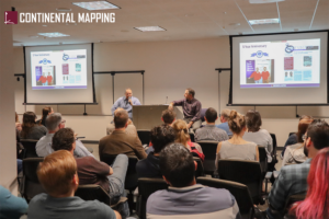 Chris Gross and Dave Hart lead an all hands meeting at Continental Mapping HQ
