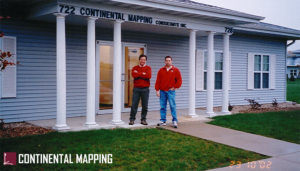 Chris Gross and Dave Heart stand outside old Continental Mapping storefront in 2002