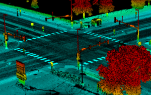 Mobile lidar point cloud visualizing an urban intersection with stoplights, crosswalks, traffics signs, light poles, and vegetation