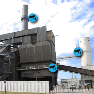 Exterior of power generation facility with surveillance camera iconography.