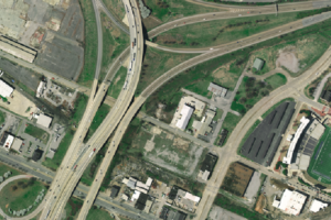 Aerial imagery of highway overpasses, buildings, and football stadium in Chattanooga, TN