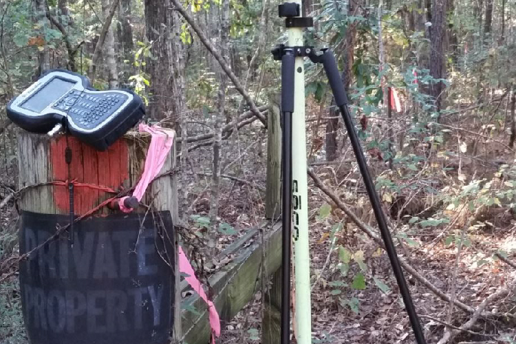 """Survey equipment set up in front of """"Private Property"""" sign at Fork Polk, LA."""