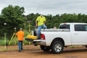 Survey crew unload truck and set up survey equipment at Fort Sill in Oklahoma.