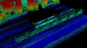 Lidar point cloud visualizing railroad tracks and trains with trees in the background in Minneapolis, Minnesota.